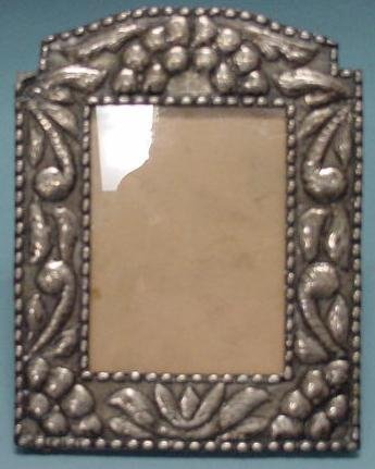 22: REPOUSSE SILVER STANDING FRAME
