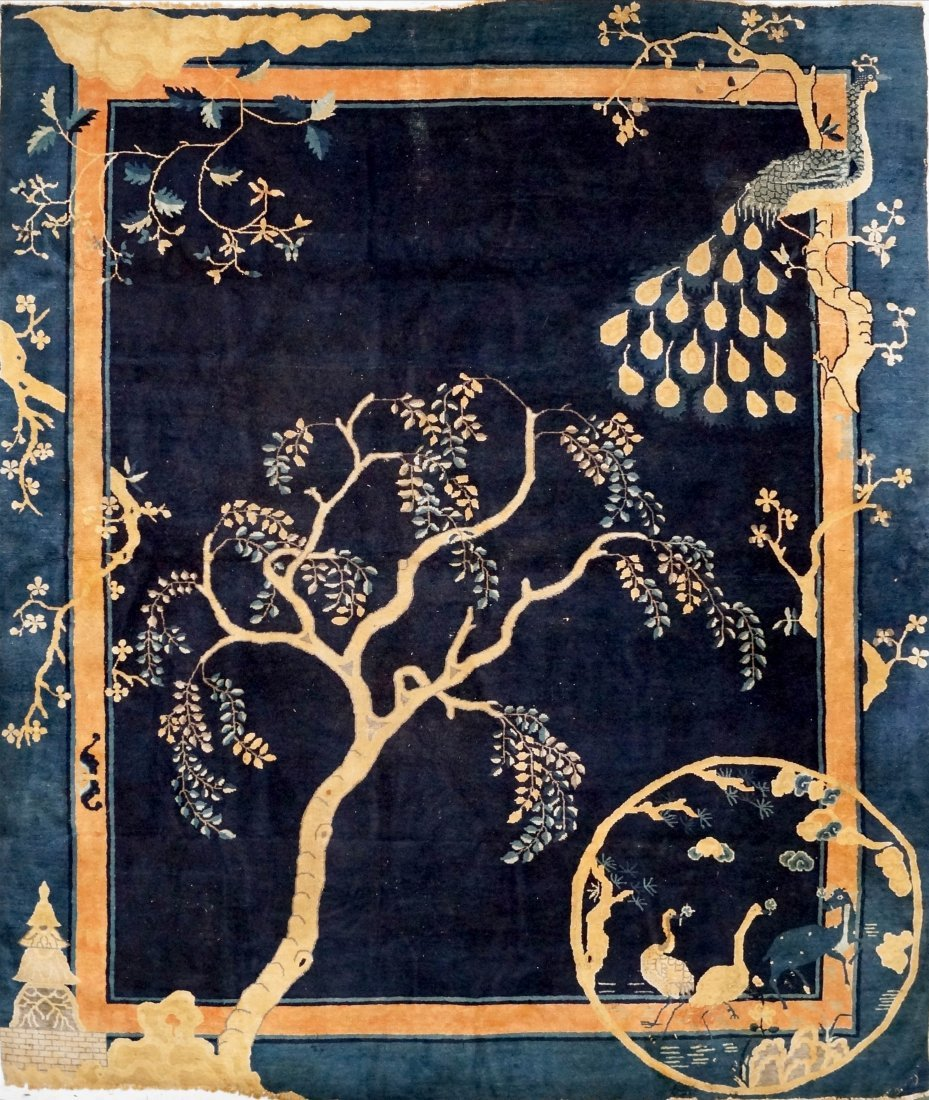 CHINESE PEKING CARPET WITH PEACOCK AND FAUNA, 19/20TH