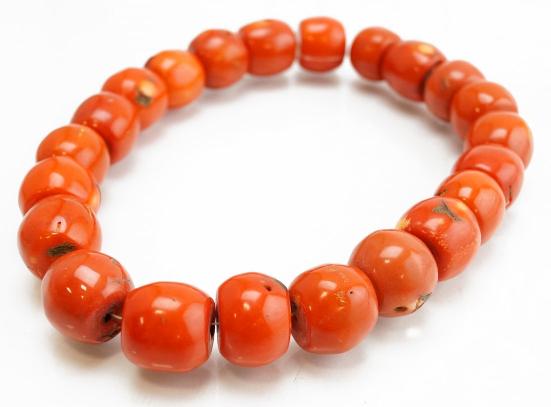 """LARGE STRAND (22) DYED RED CORAL BEADS. LENGTH 16"""";"""