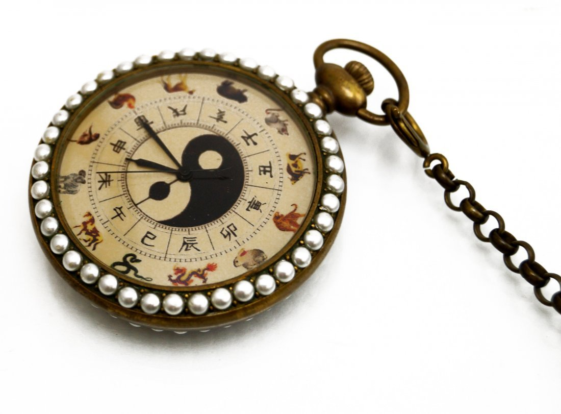 ENAMELED BRASS POCKET WATCH WITH CHINESE YIN/YANG DIAL,