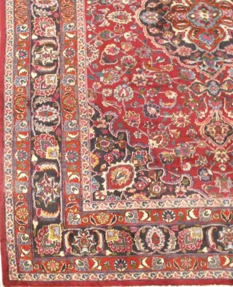 1011: ANTIQUE PERSIAN MASHAD CARPET