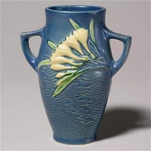 """Roseville Freesia vase, blue, 117-6"""", nicks."""