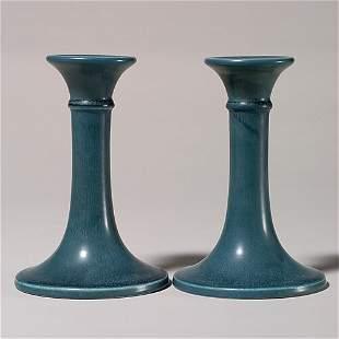 Pair Rookwood blue mat production candlesticks, 1
