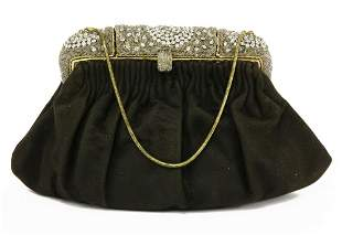 A vintage black suede evening bag