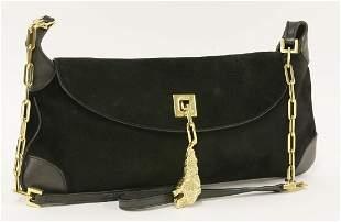 A Gucci black suede shoulder bag
