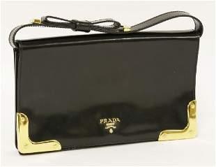 A Prada black patent leather clutch handbag