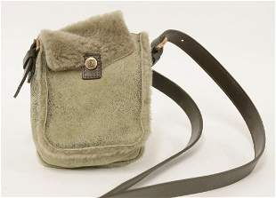 A Tods black leather micro handbag