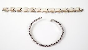 11: A sterling silver twisted wire torque bangle, by Ju