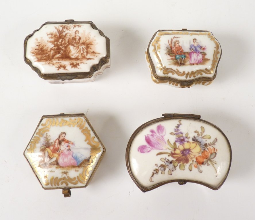 Four Continental porcelain and hand painted Snuff Boxes