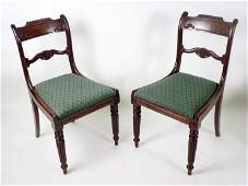 A set of seven Regency mahogany dining chairs, with car