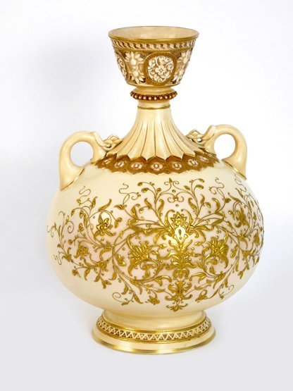 A Royal Worcester blush ground Vase, the twin-handled v