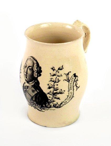 A creamware Mug, c.1765-70, the bulbous body printed in