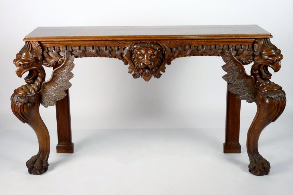 IN THE MANNER OF GILLOWS A boldly carved oak pier table