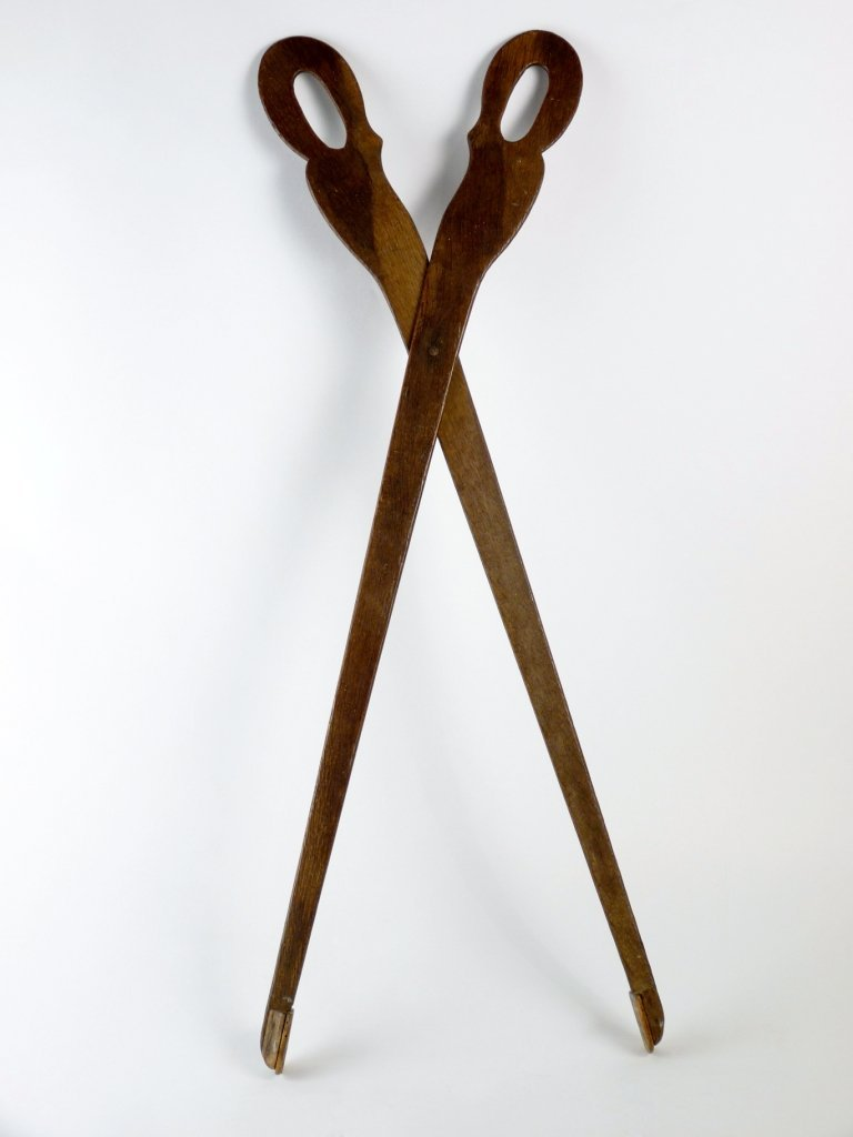 A pair of Victorian oak library tongs with a scissor ac