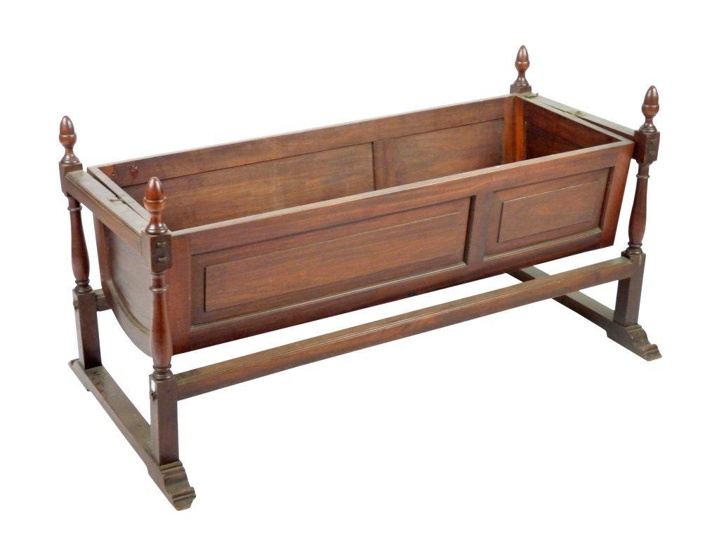 A mahogany campaign crib, early 19th century, the panel
