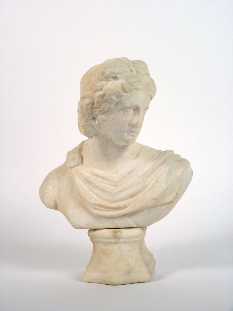 An early marble bust of a Roman goddess on a socle base
