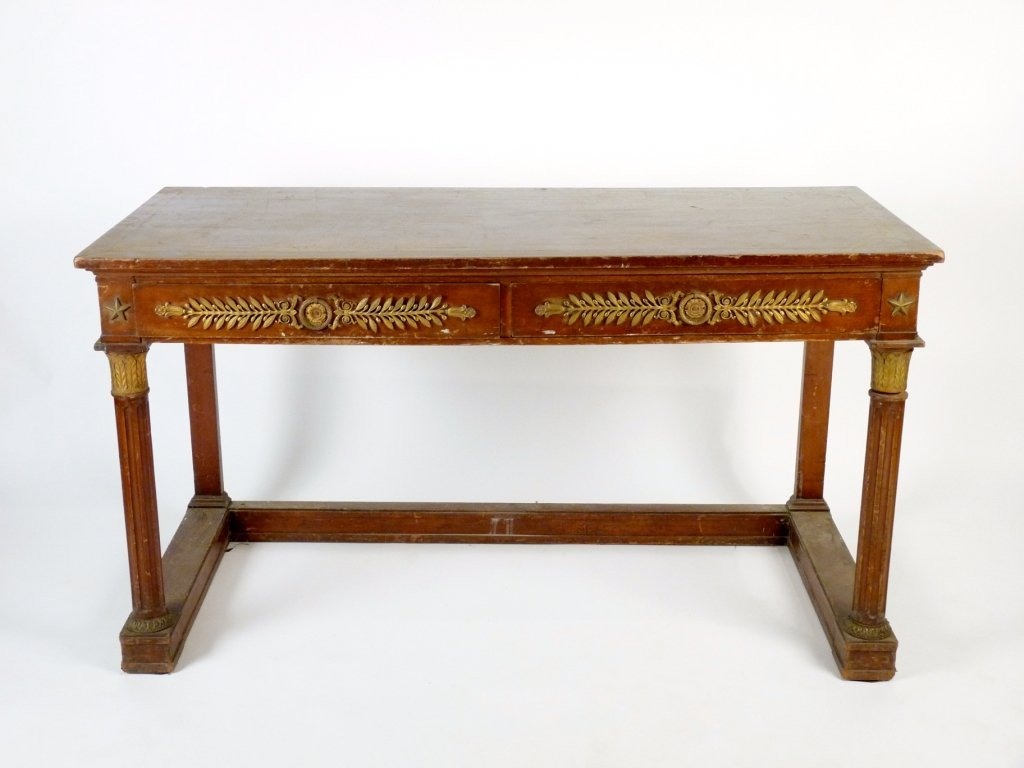 An Empire-style mahogany writing table, with two frieze