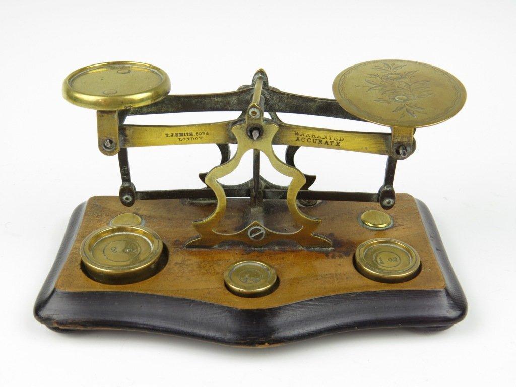A set of brass postal scales,  1871-1897, the beam stru