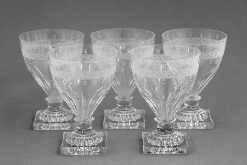 Five George III Rummers, each with a band of engraved