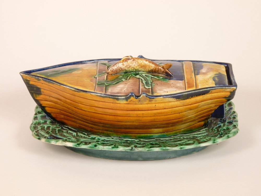 A majolica boat-shaped sardine box and cover, c.1875,