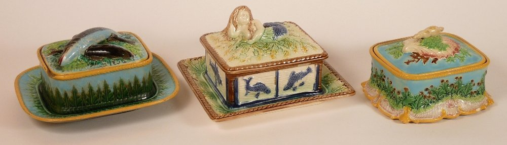 Three majolica sardine boxes and covers, a majolica