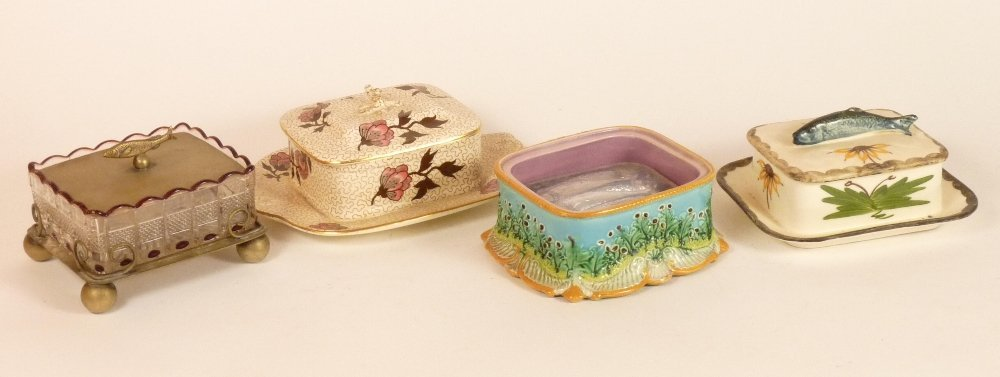 Four sardine boxes, a majolica box, moulded with