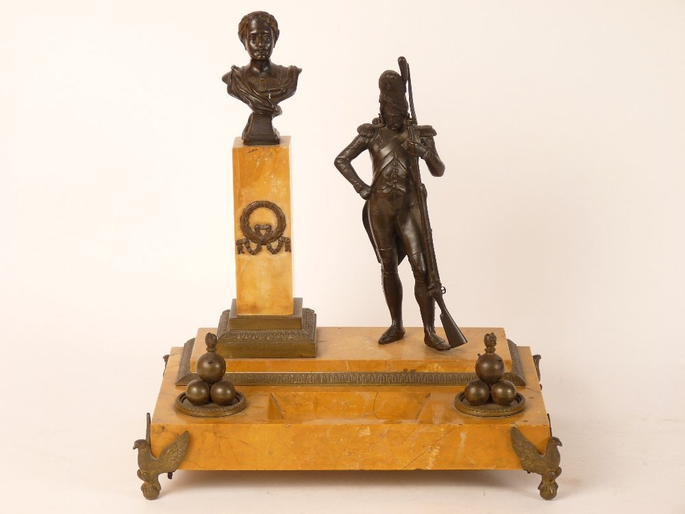 A French Empire Period bronze and Sienna marble