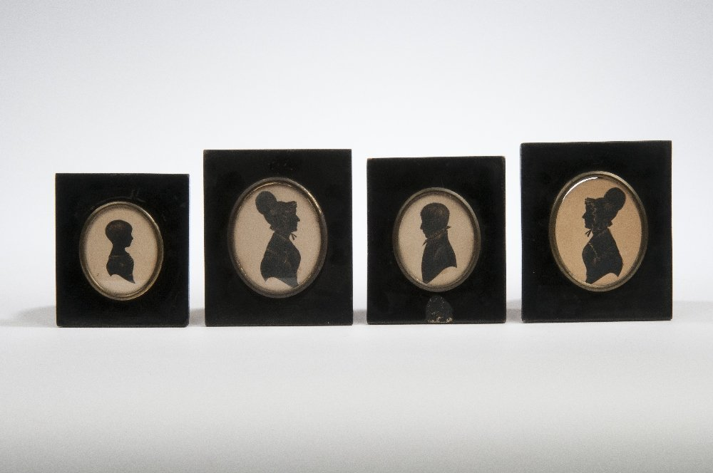Four silhouettes, mid 19th century, in ebonised frames,