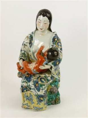 An unusual Kutani Group, second half 19th century, of a
