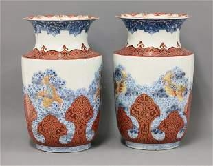 An unusual pair of Arita Vases, c.1870, each painted in