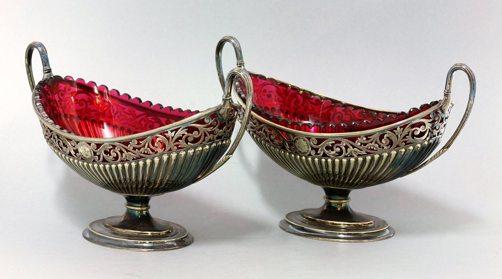 A pair of Edwardian silver-plated two-handled dishes,