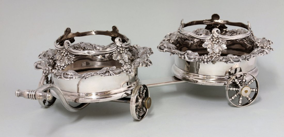 A Victorian silver-plated wine bottle trolley, the pair