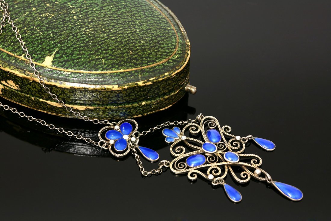 A silver and enamel sølje pendant,  by Marius Hammer,