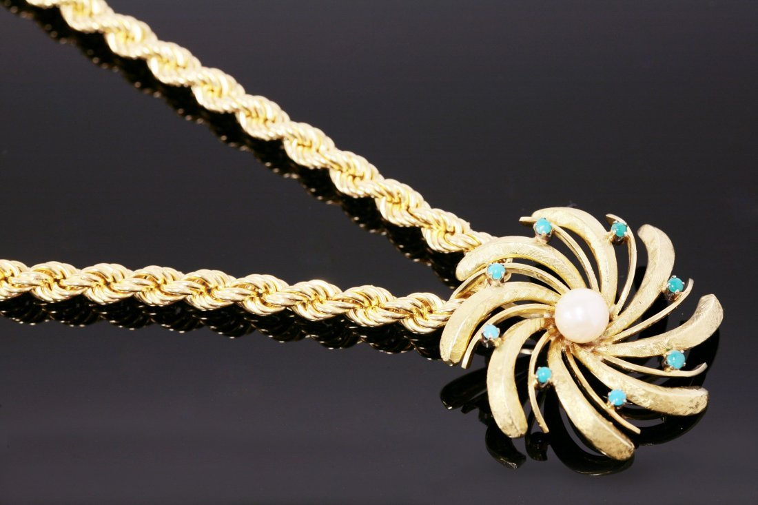 A Continental cultured pearl and turquoise pendant,