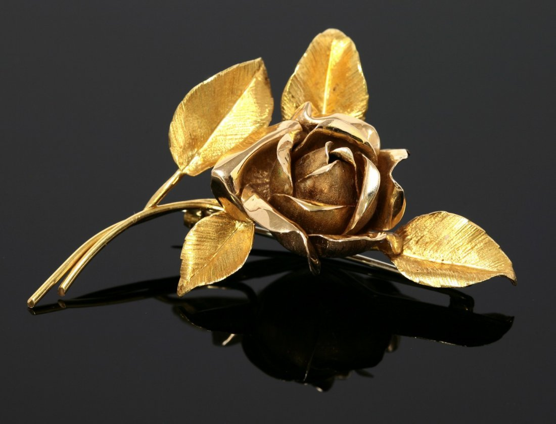A gold rose brooch,  c.1960, with a naturalistically