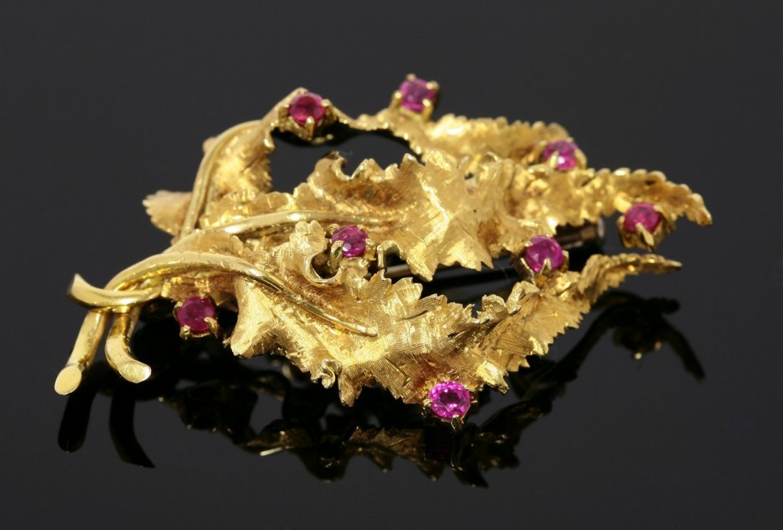 A Continental 18ct gold ruby set seaweed brooch,