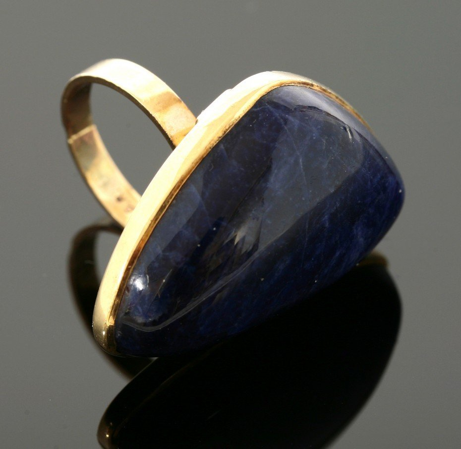 A gold sodalite ring,  c.1970, with a triangular,