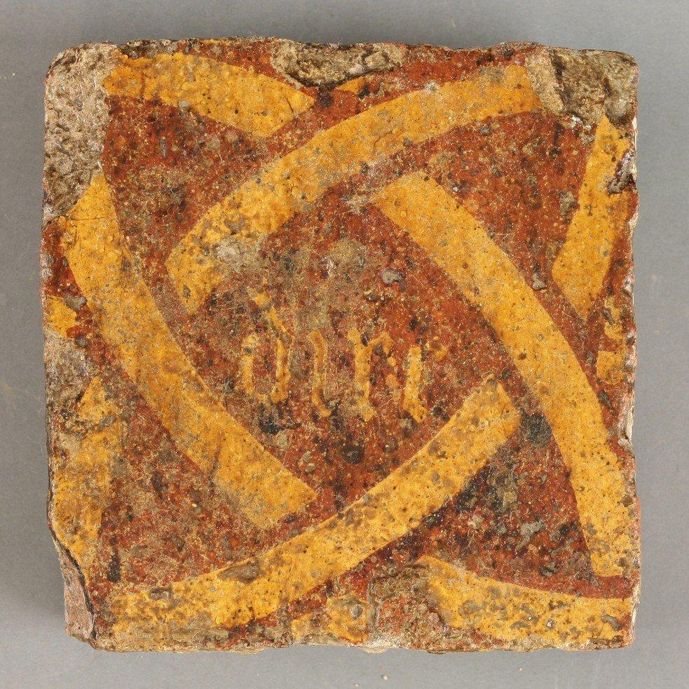 A rare set of thirteen encaustic Tiles,    14th-15th