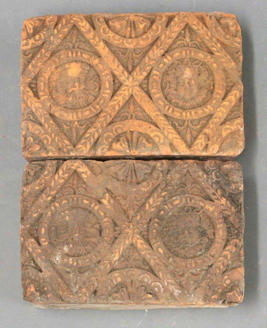A pair of rare terracotta Tiles,    1594, each of deep