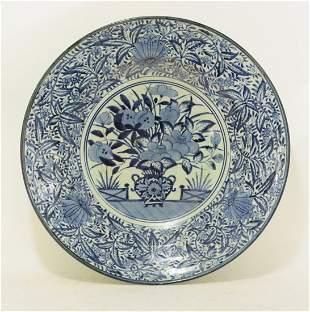 An Arita large Dish, c.1690, painted in underglaze blue