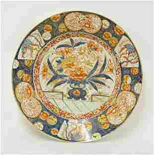 A large Arita Dish, c.1690, painted in the Imari