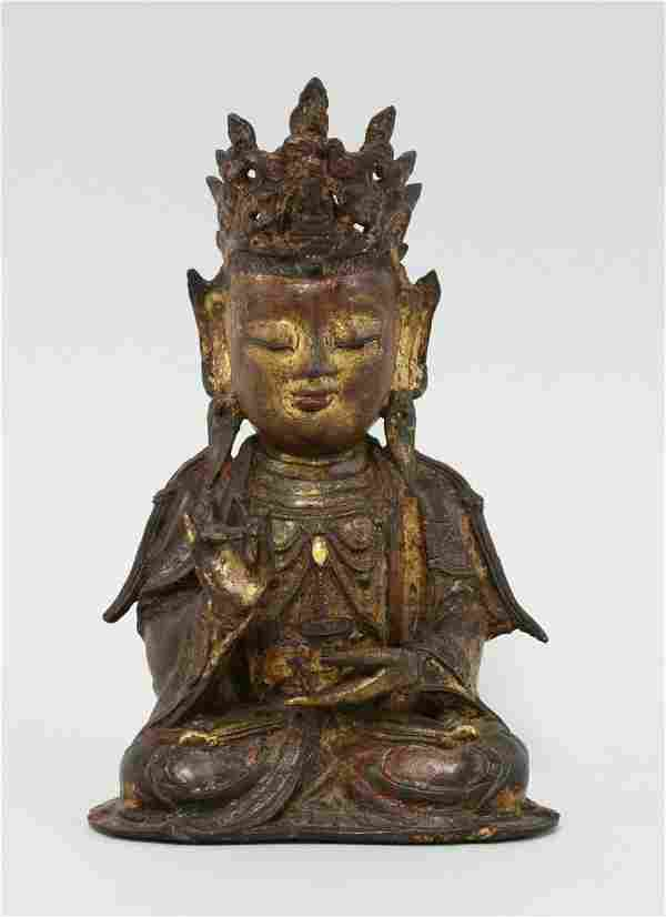 A bronze Guanyin, late Ming dynasty, the figure seated