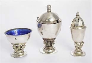 A Danish metalwares three-piece acorn pattern condiment