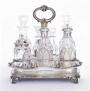 A William IV silver seven bottle cruet, by Barnard