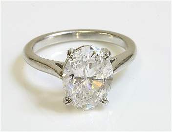 A single stone diamond ring, with an oval brilliant cut