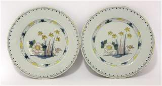 A pair of delft Plates, c.1780, each painted in