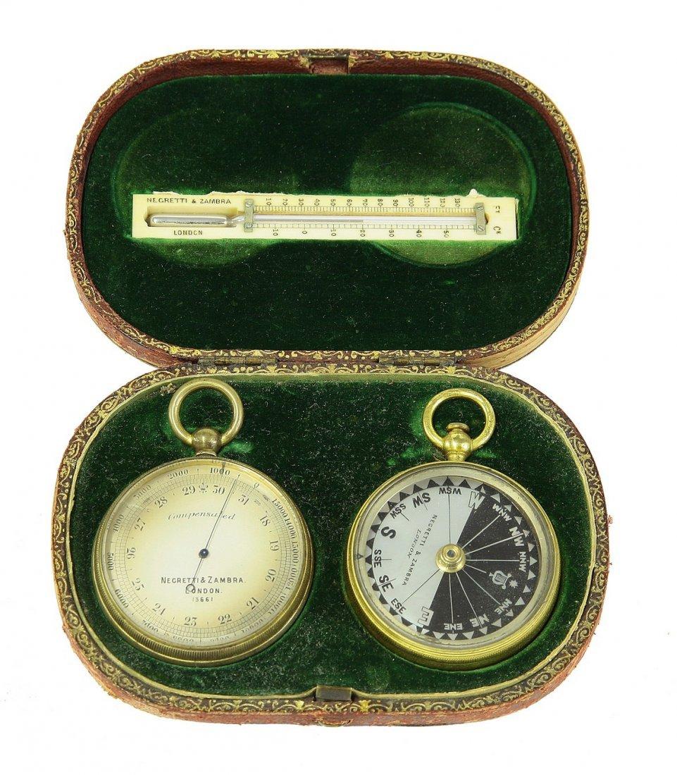 A Negretti & Zambra pocket compass, barometer and