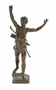A bronze figure cast as a triumphant warrior, by