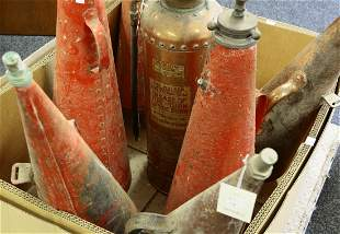 Six conical metal fire extinguishers, one by Minimax,