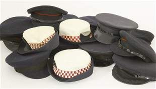 A large selection of fire brigade peak caps, from